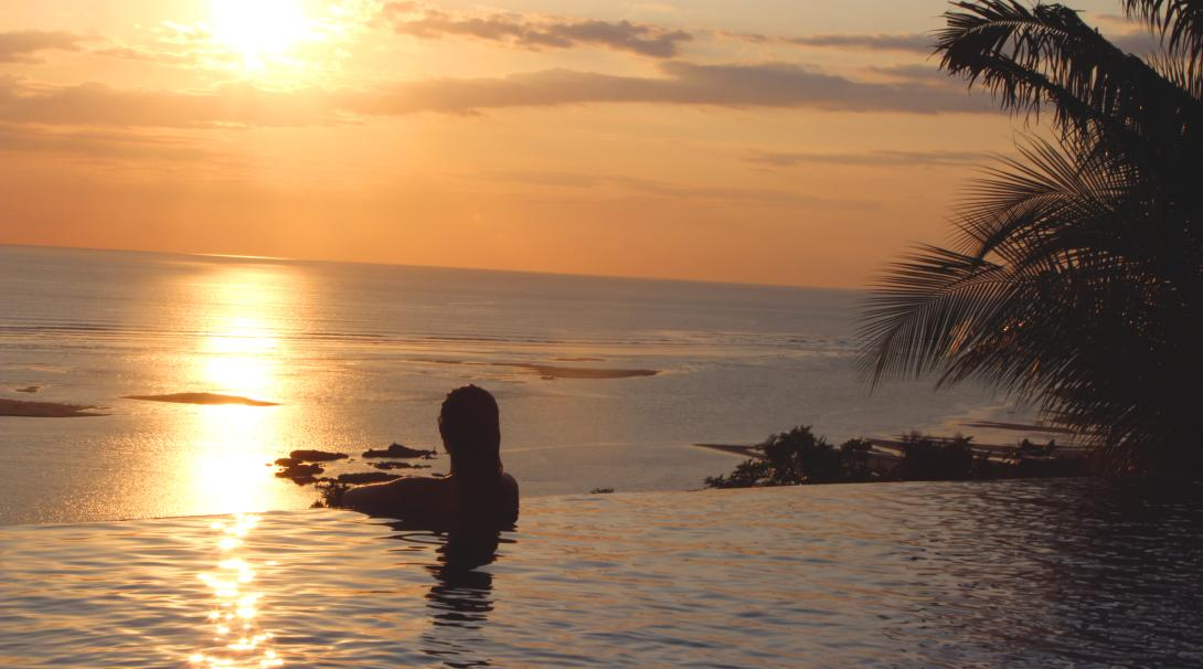 Volunteer enjoys the sunset in a pool in Costa Rica.